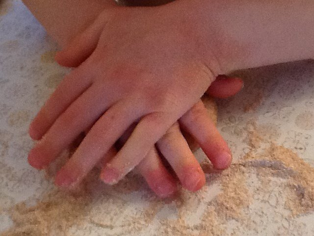 making pizza with kids - kneading the dough
