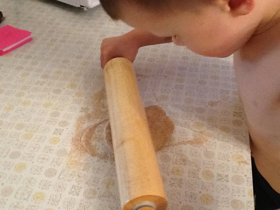 making pizza with kids - rolling the dough