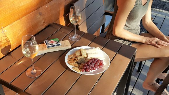 Healthy Snacks on Vacation - crackers and cheese from home served with local grapes purchased at a farm stand near our cabin and wine from a local winery